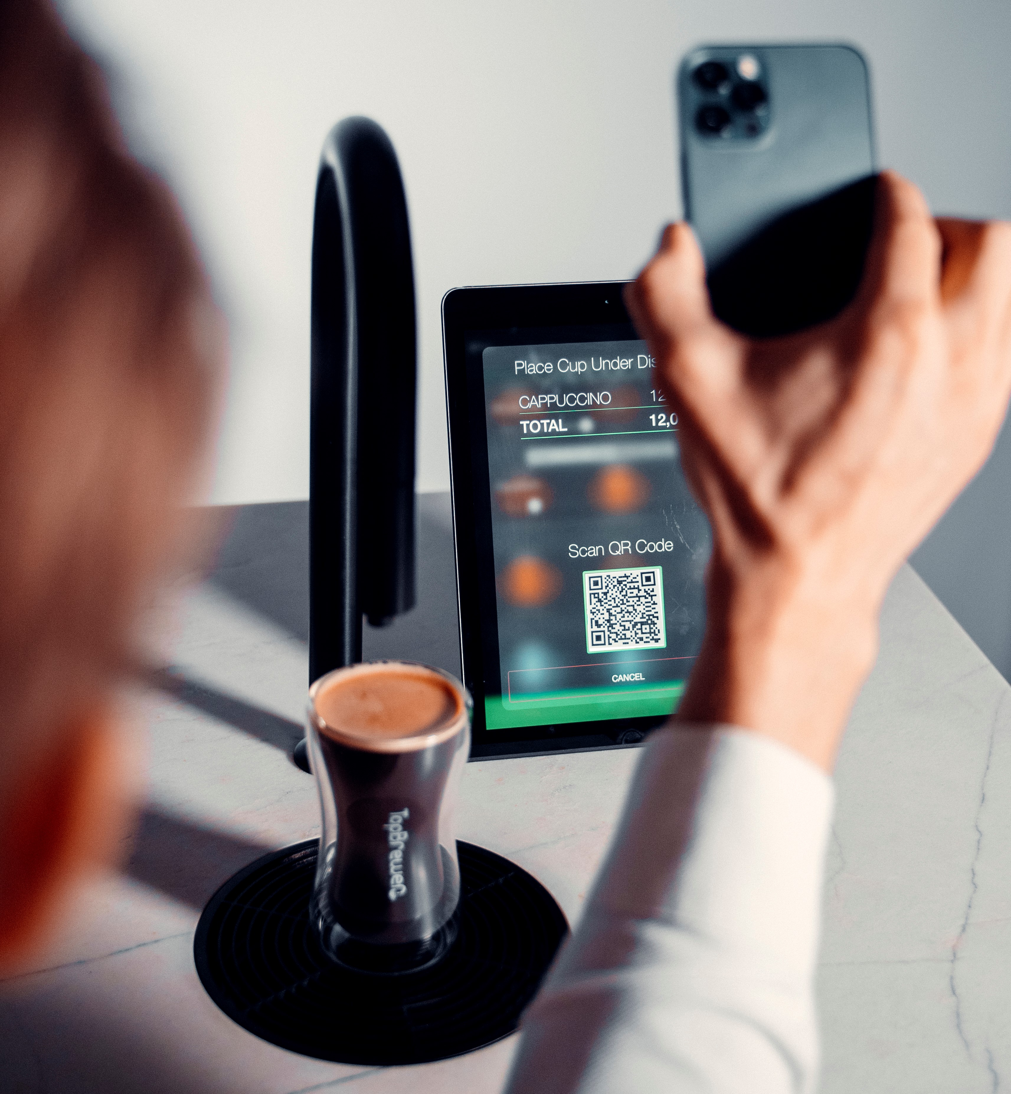 A member making a coffee by scanning QR code