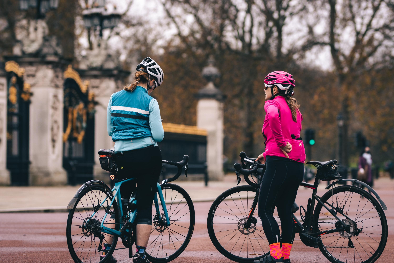 Two women riding bikes. Photo by @jordanbrierley