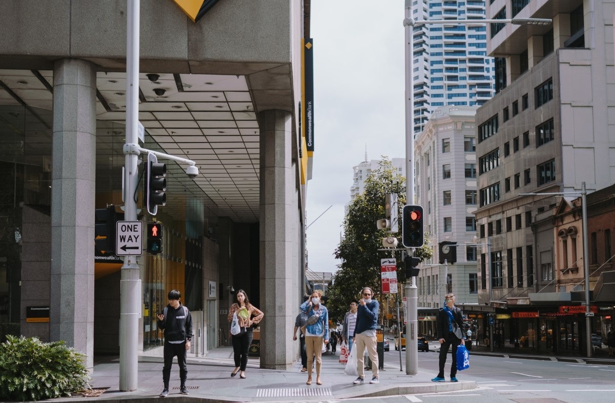 People walking through streets of Sydney - Credit to @katetrifo, image supplied via Unsplash