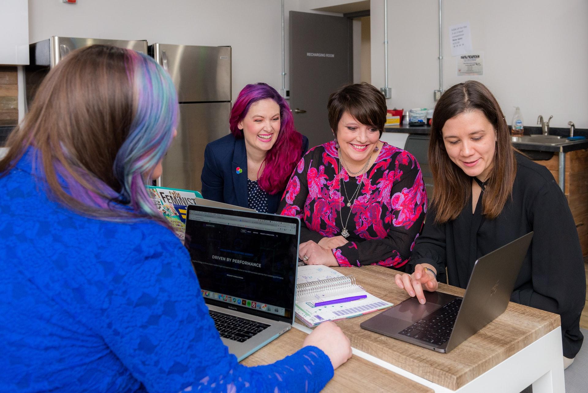 Female coworkers using a laptop. Photo by @kyliehaulk via Unsplash