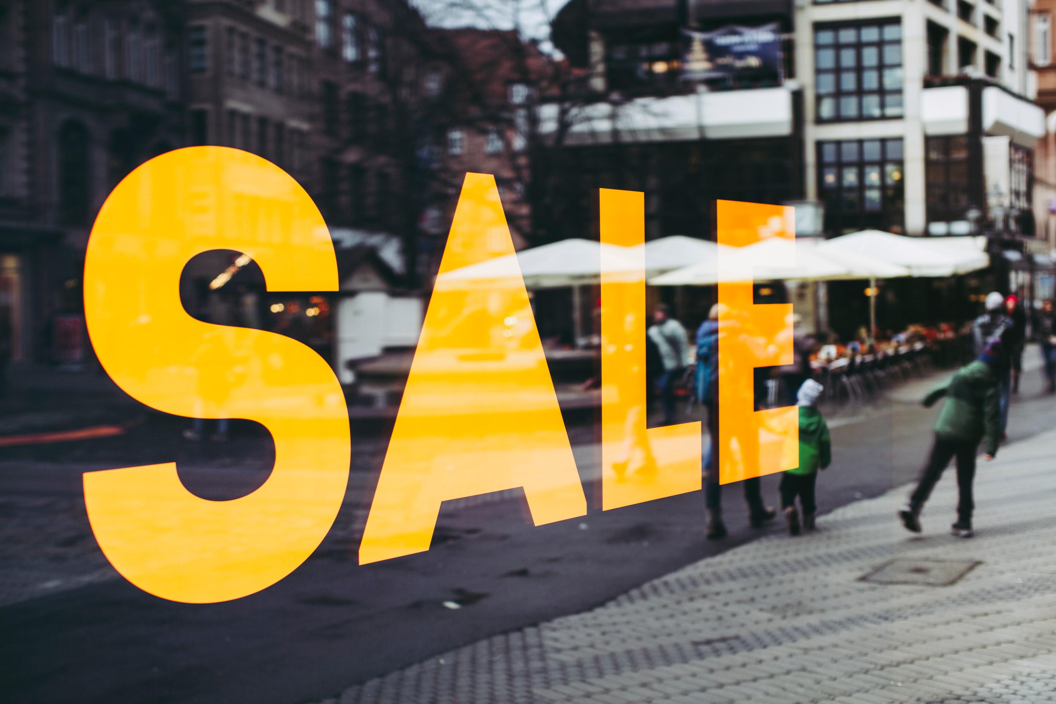 'Sale' advert on high street. Photo by @markusspiske via Unsplash