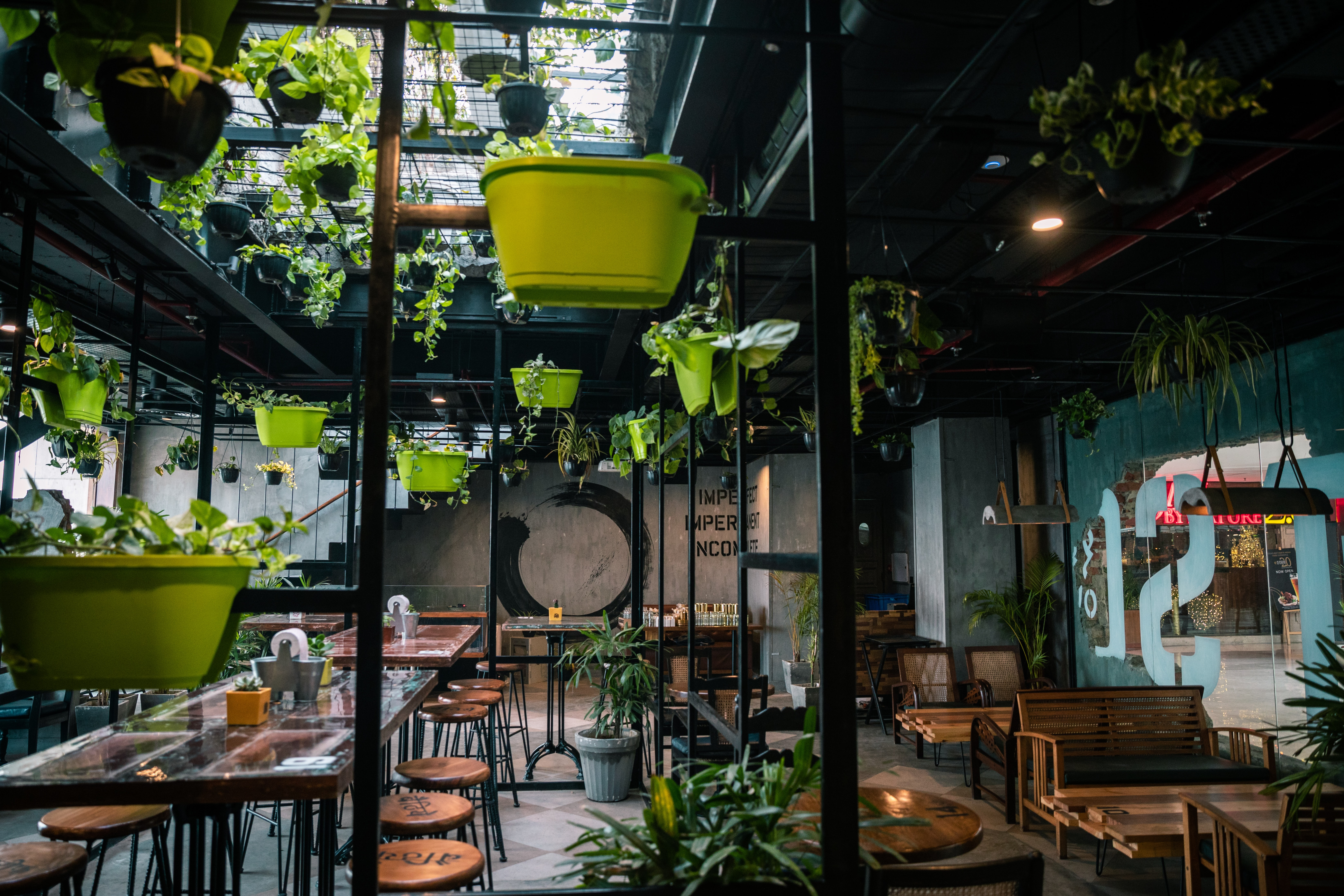 Flexible workspace with lots of wooden seating and plants
