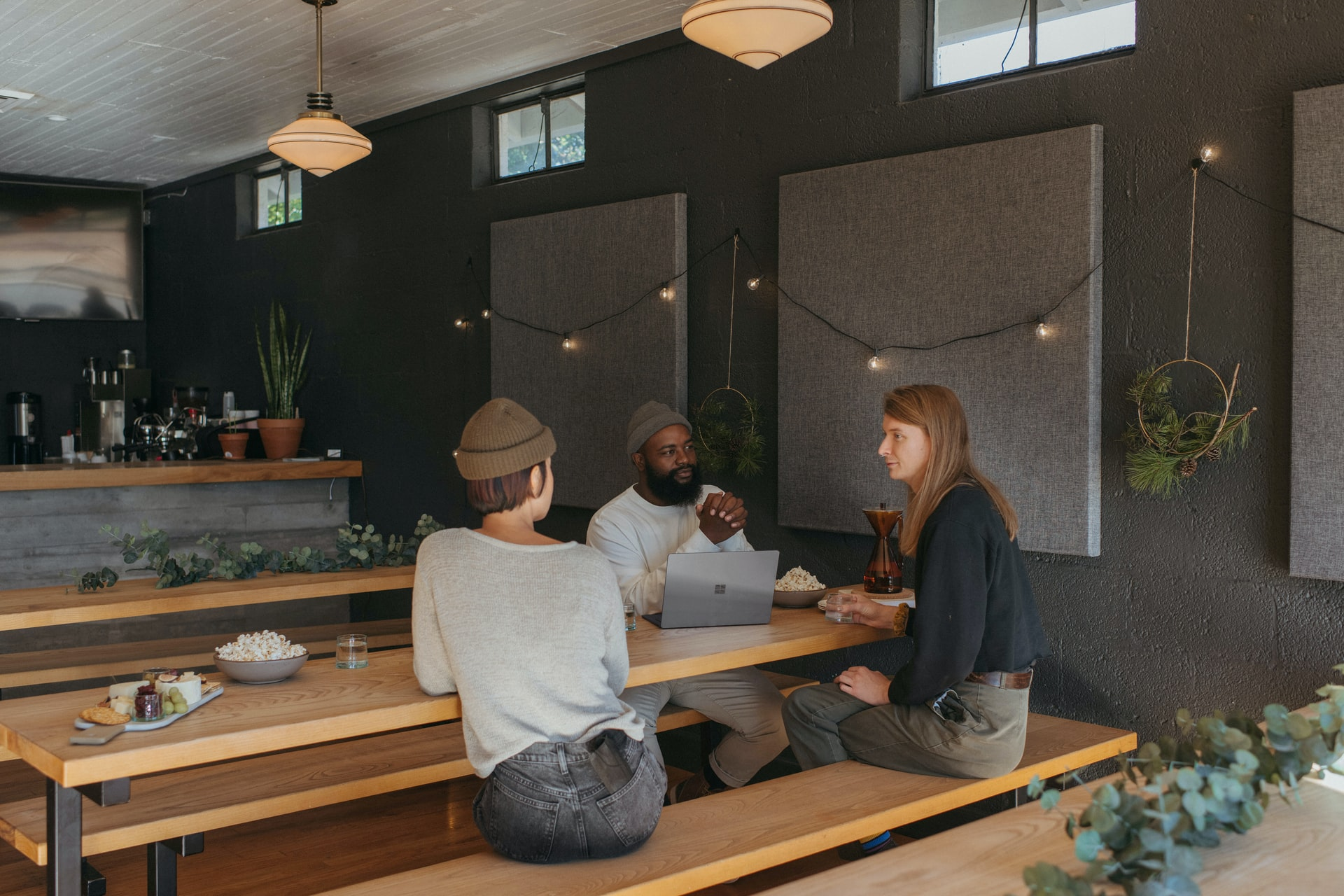 Coworking space colleagues chatting. Photo by @Surface via Unsplash